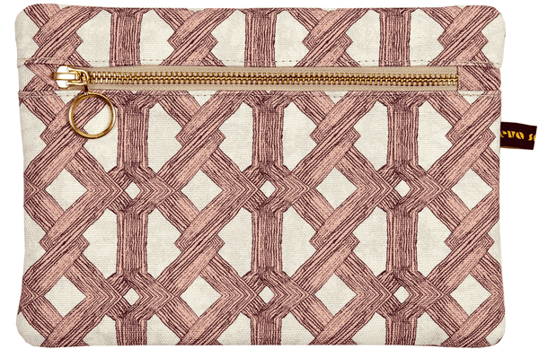 Luxury African batik print envelope bag with soft pink geometric pattern and gold zip