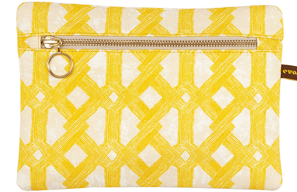 African batik print envelope bag with bright yellow geometric pattern and gold zip