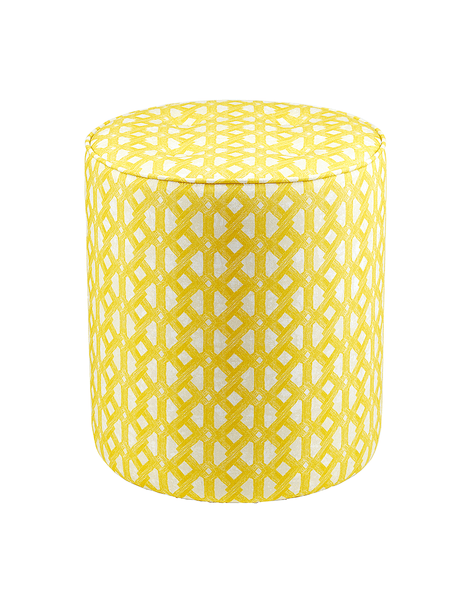Bright yellow pouffe with geometric African print pattern