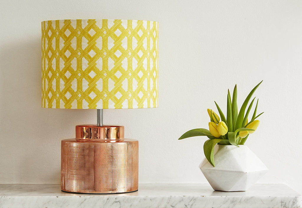 Elegant African batik print lampshade with bright yellow geometric pattern