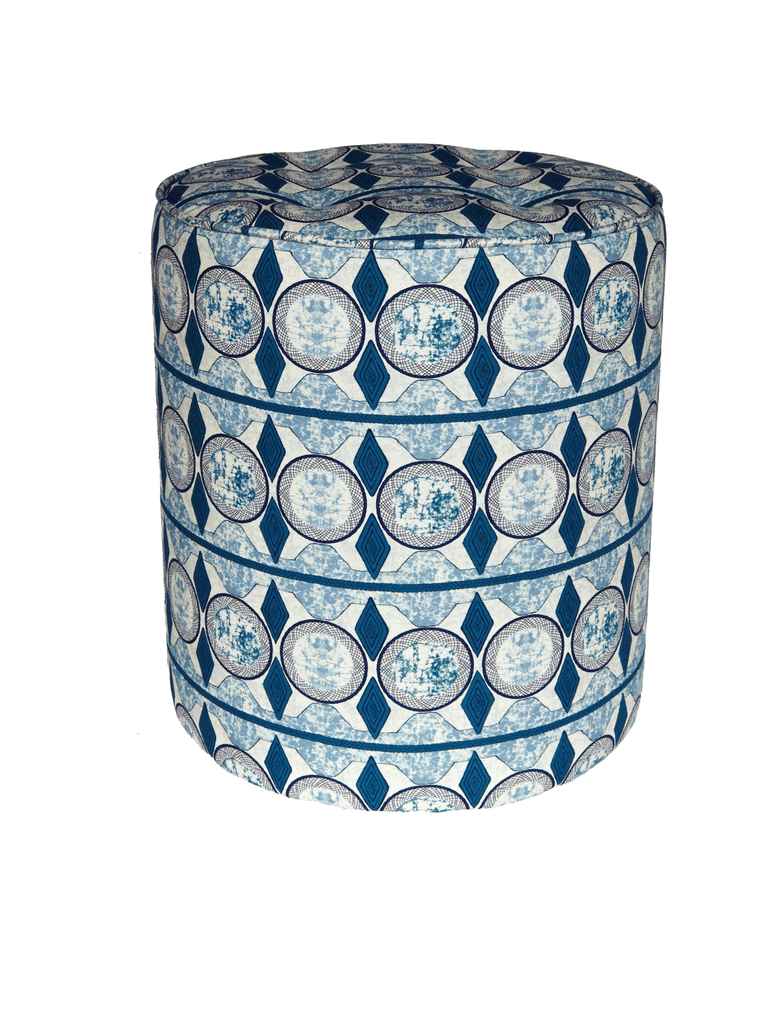 Vibrant blue and white pouffie with bold African print design