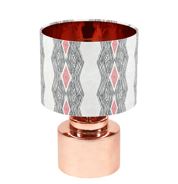 Modern geometric African table lamp with bold grey and pink pattern