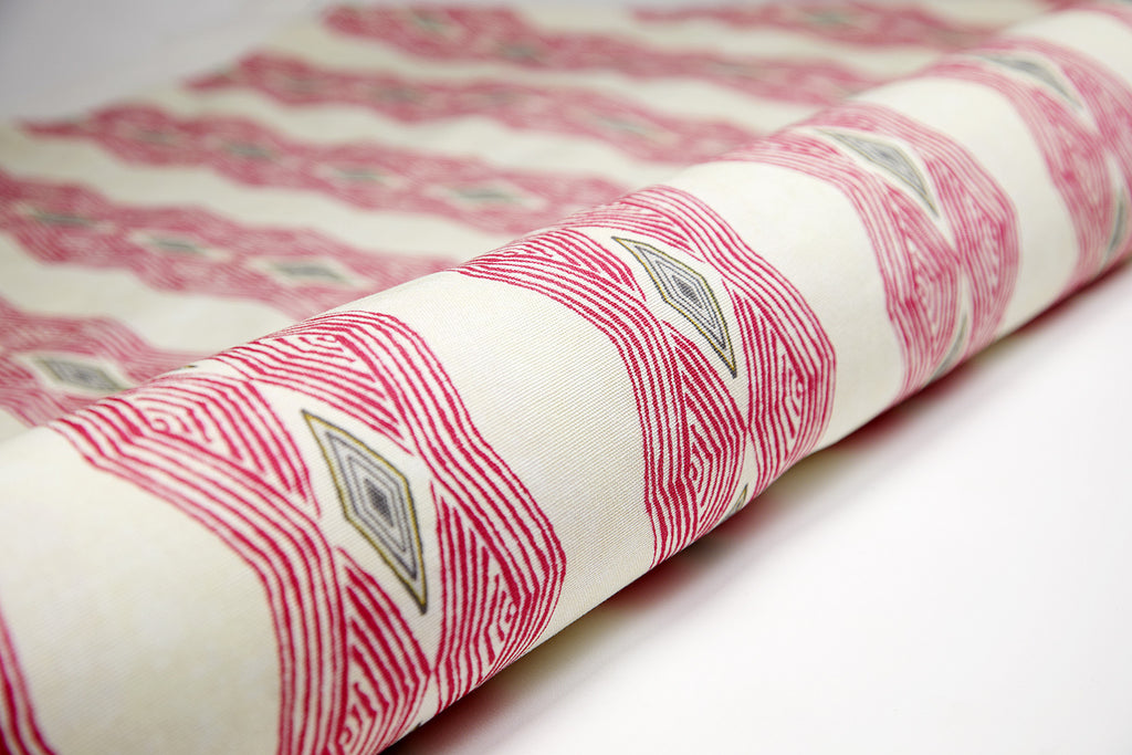Colourful geometric African interior fabric with bold vibrant pink pattern
