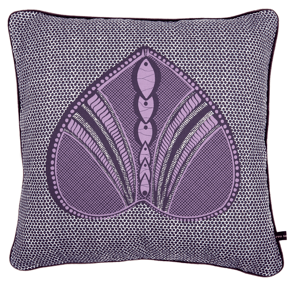 Vibrant purple African cushion with heart shaped pattern on polka dot background