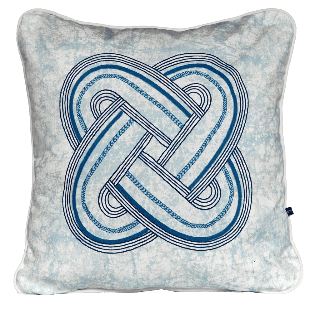 Elegant African cushion with circular blue tribal pattern in on blue batik base