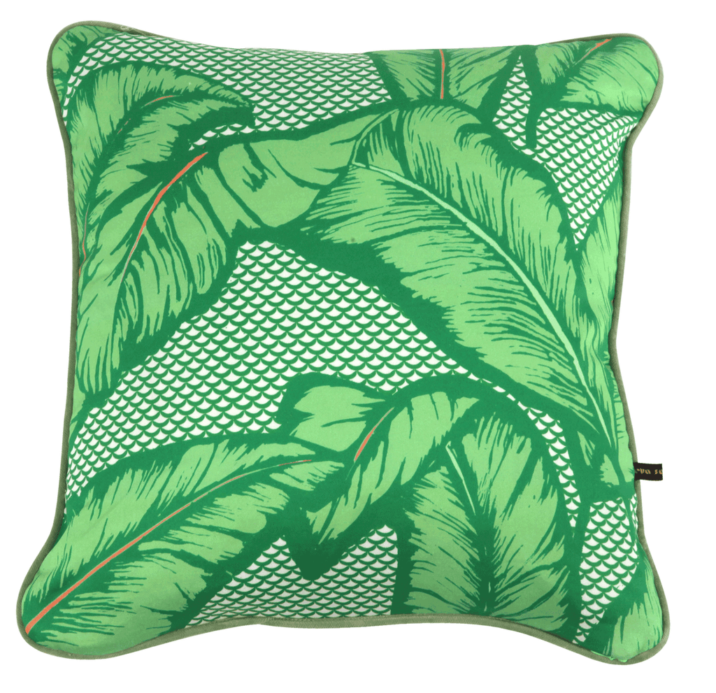 Vibrant African cushion with bold green palm leaf design