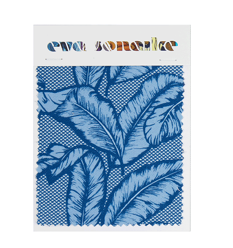 Vibrant African inspired upholstery fabric with tropical blue palm leaf design