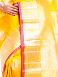 Kanchipuram Silk Saree in Yellow + Thilagam Motifs + Elegant Broad Border in Pure Zari with Yali Motifs