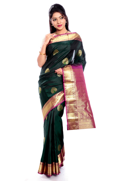 Dark Green kanjivaram silk saree with golden Border