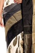 Ikkat silk saree in off white with black border