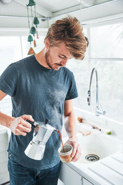 Casey of Canyon Coffee pouring fresh coffee from a moka pot into a mug | Making coffee with a bialetti | Coffee rituals