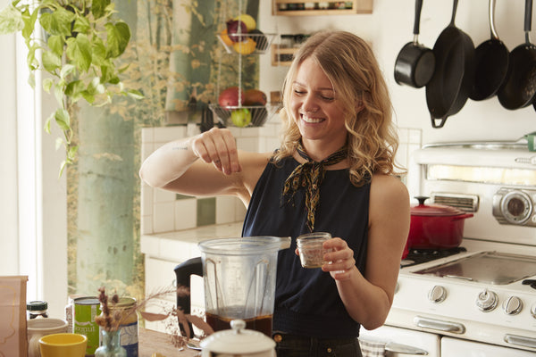 Kacie Carter, owner of Honey Hi, making a blended coffee drink with Canyon Coffee