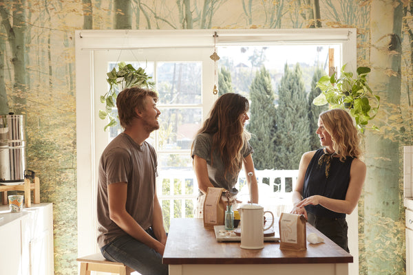 Casey and Ally, owners of Canyon Coffee, having coffee with Kacie Carter, owner of Honey Hi, in her sunny Los Angeles apartment
