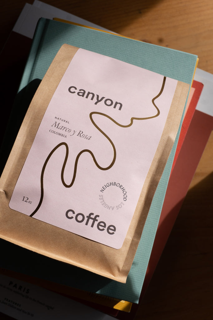 a 12oz bag of Marco y Rosa natural microlot by Delagua Coffee, a collaboration with Neighborhood and Canyon Coffee