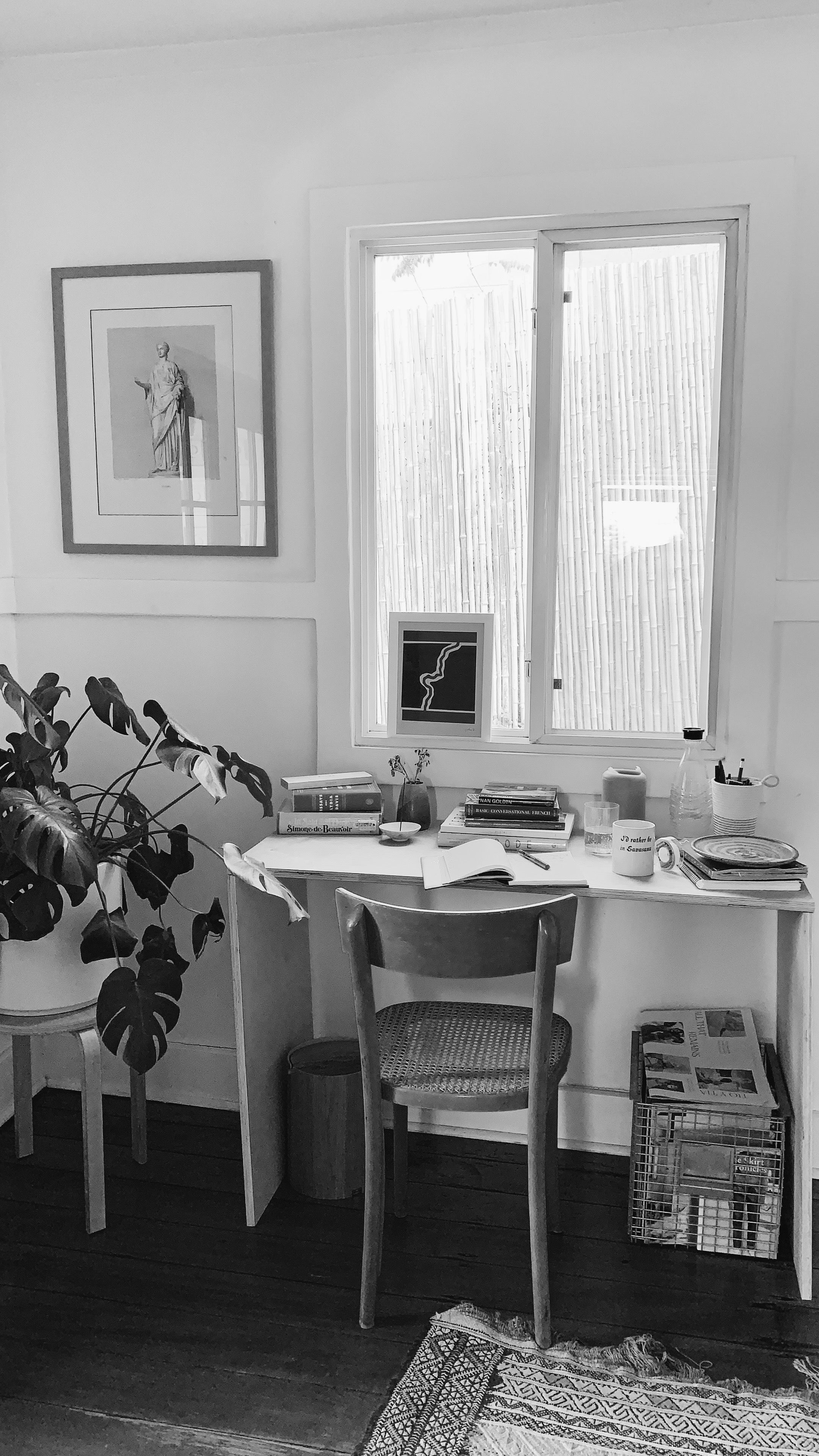 Black and white photo of the home writing desk of Ally Walsh, co-founder of Canyon Coffee
