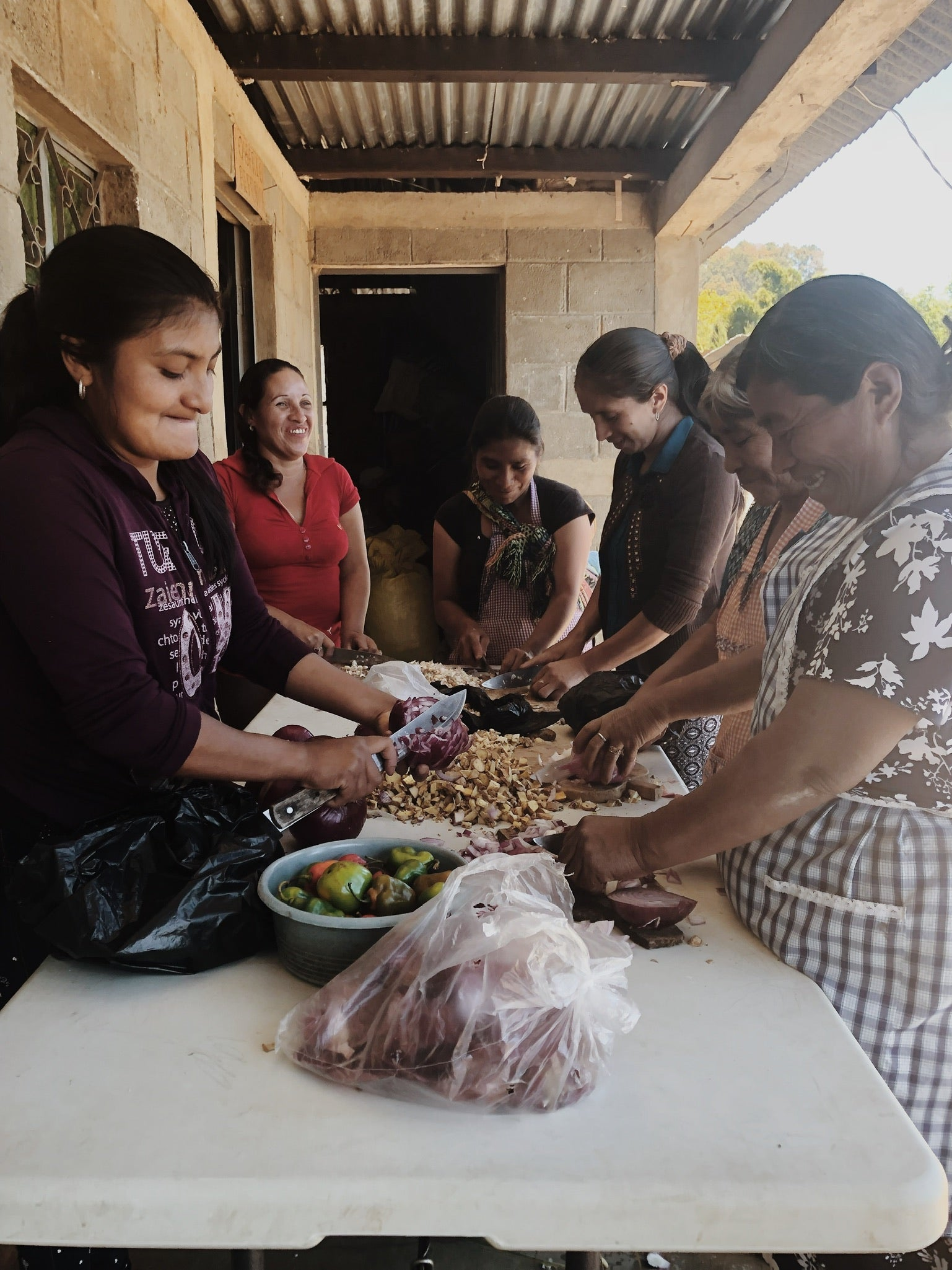 Women farmers of the ACODIHUE co-op in northern Guatemala preparing natural organic pest repellants