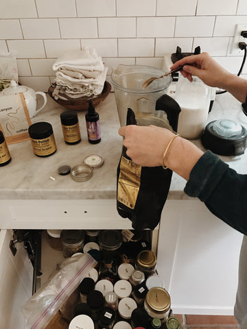 Lacy Phillips making a special tonic for Canyon Coffee, with a home apothecary of different herbs and superfoods