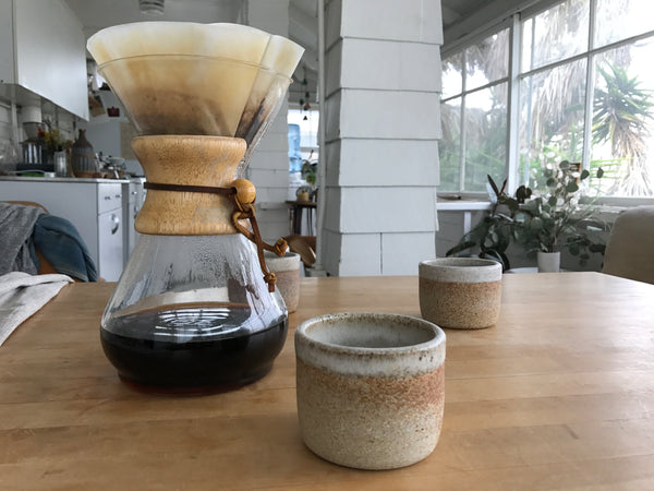 Chemex coffee | Chemex and ceramic mug on kitchen table | Canyon Coffee