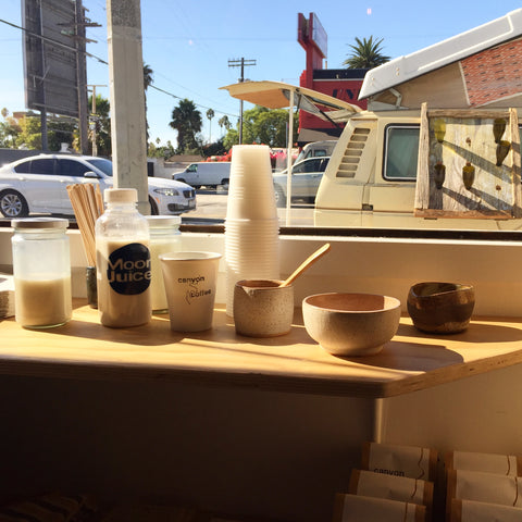 Moon Juice and Canyon Coffee at the Canyon Coffee pop up in Los Angeles, CA. Vintage van in the background is the setup of Untho's Fiores and the Unlikely Florist.