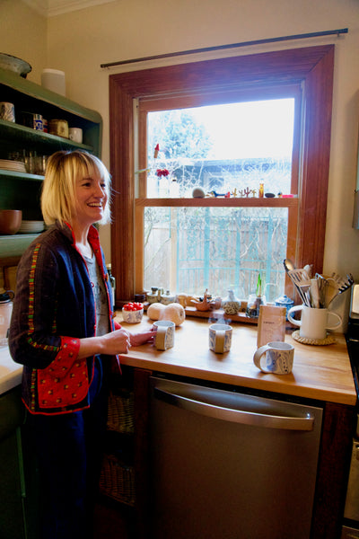 Painter Michelle Blade in her kitchen in Portland, OR, with bag of Canyon Coffee on the counter
