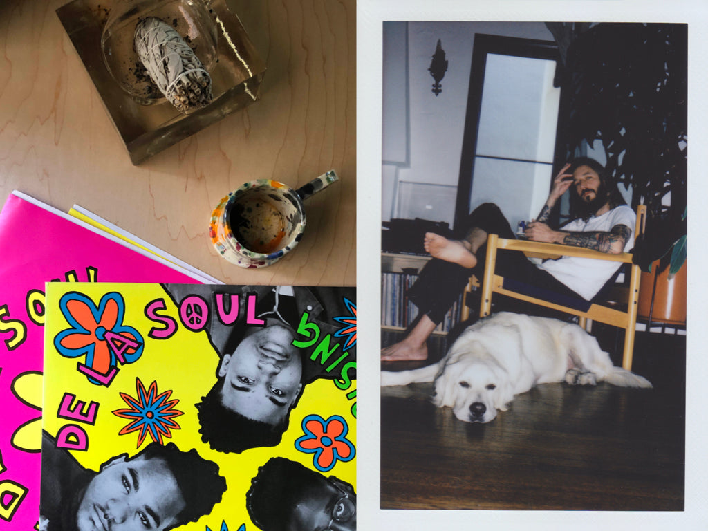 Photo of De la Soul records with Peter Shire coffee mug on left, photo of artist and designer Mike McMullen with his dog on the right