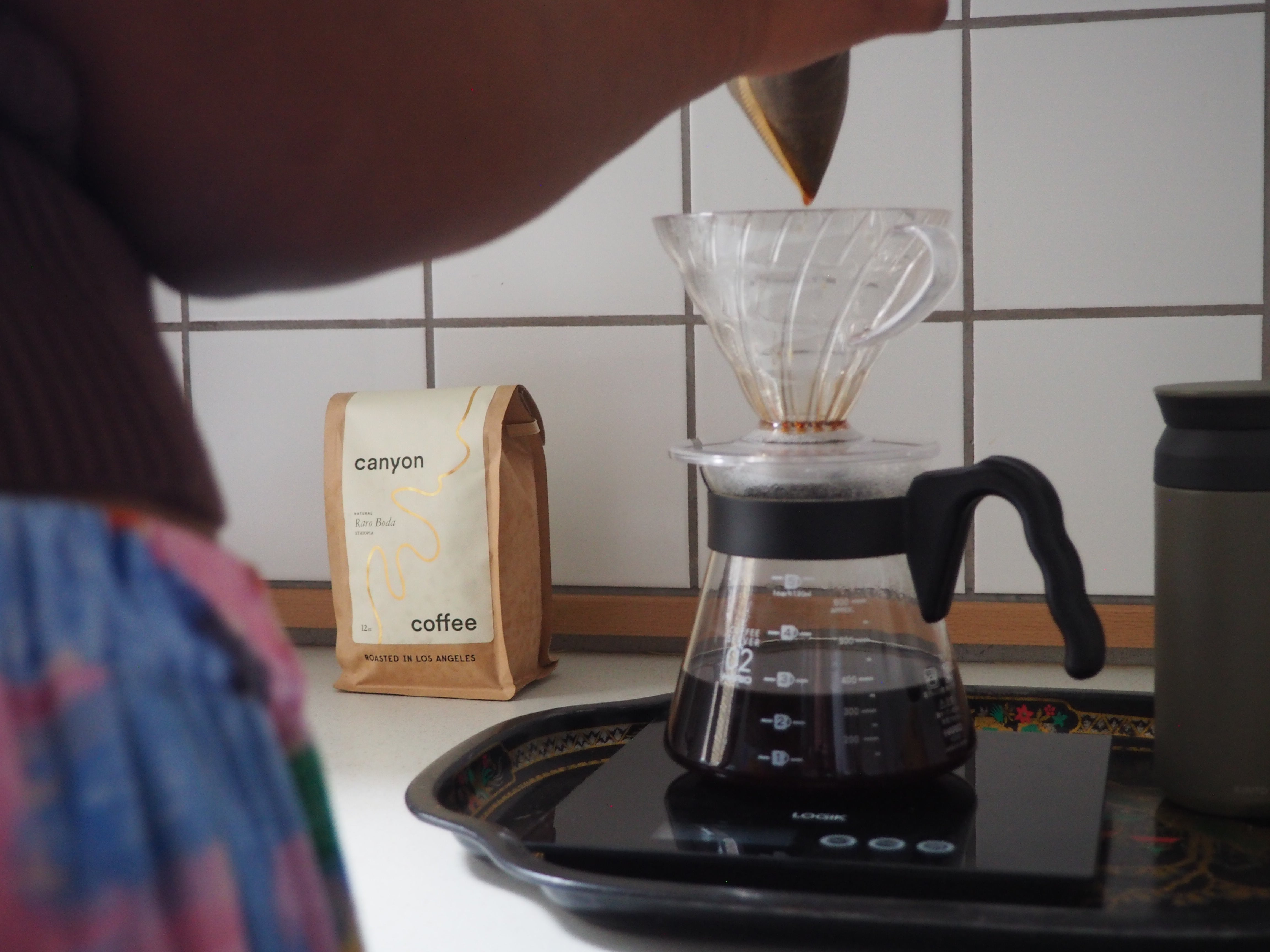 Tara Thomas brewing a pour over of Canyon Coffee in her kitchen in Copenhagen, 2020