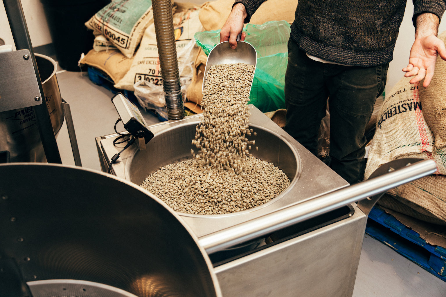 Canyon Coffee weighing in green coffee to be roasted on their Loring Kestrel in Los Angeles