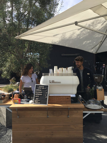 Ally Walsh and Casey Wojtalewicz, owners of Canyon Coffee, working the La Marzocco espresso machine of Welcome Coffee Cart