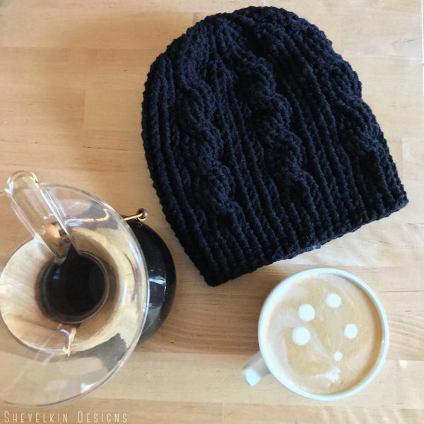 Black Cable Slouchy Beanie Hat flat on table