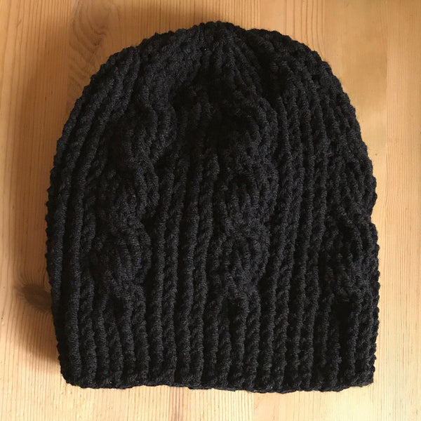Black Cable Slouchy Beanie Hat flat on table side two