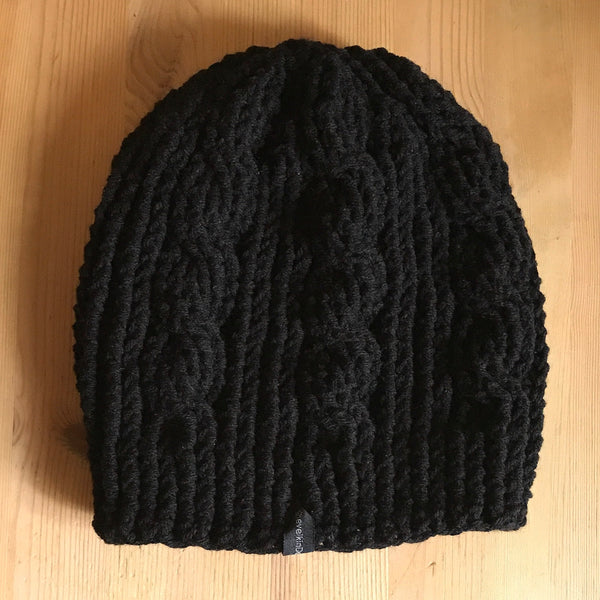 Black Cable Slouchy Beanie Hat flat on table side one