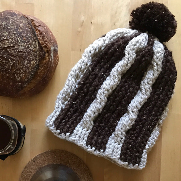 Slouchy Winter Hat, Brown and Cream Cable on Table from Above