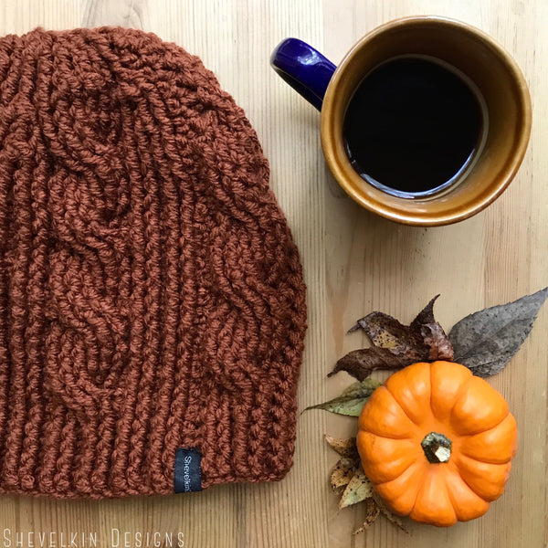 Burnt Orange Cable Slouchy Beanie on Table Flat Lay