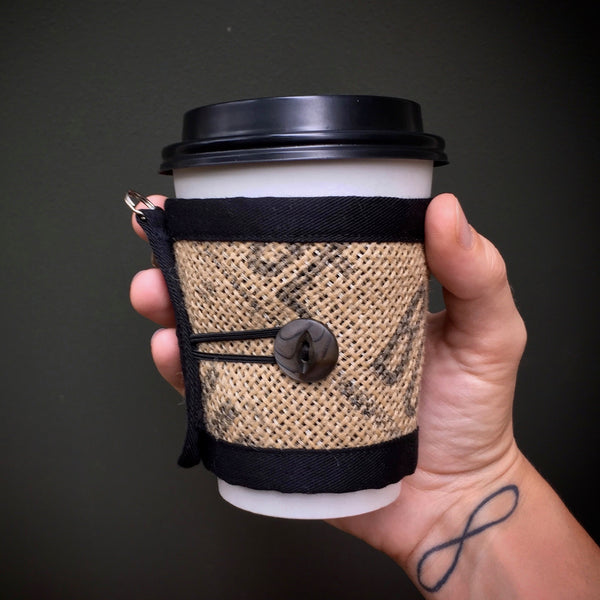 Coffee Cozy for travel or disposable cups with black button and black text