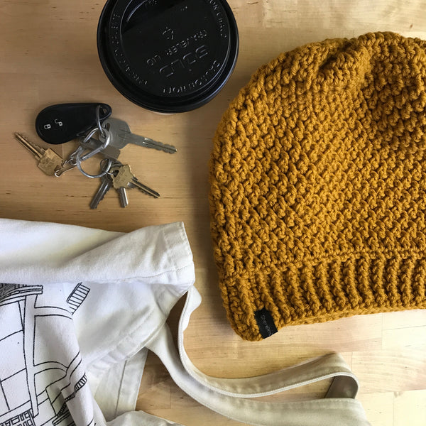 Mustard Yellow Slouchy Beanie, Slouchy Hat, Slouchy Beanie, Womens boho hat, crocheted hat, oversized hat, boho hat, dread hat, mustard yellow hat, yellow hat, handmade hat, on table flatlay