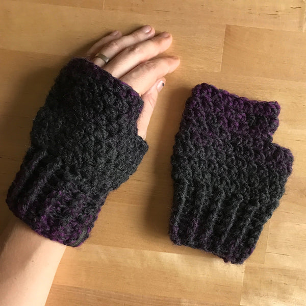 Black and Purple Wool Fingerless Mittens, Front on Hand, Inside on Table