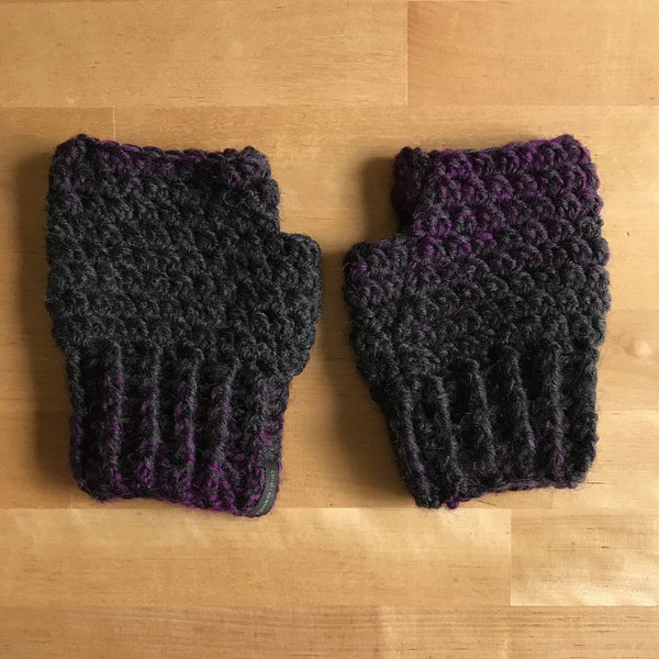 Black and Purple Wool Fingerless Mittens, Front on Table