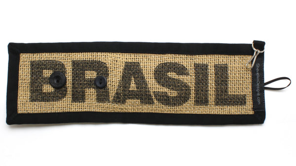 """BRASIL"" Reusable Adjustable Cozy Featuring Black Text and Non-Matching Black Buttons"