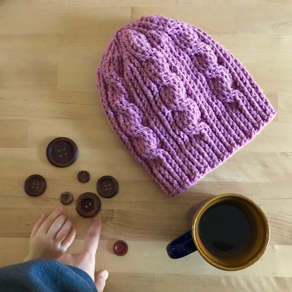 Mauve Cable Slouchy Beanie Hat flat on table
