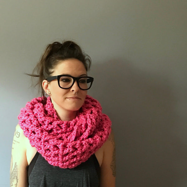 Pink infinity scarf folded on person