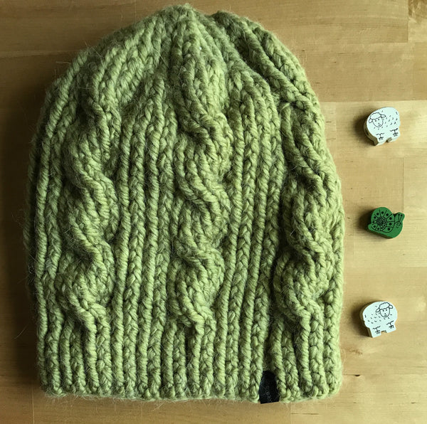 Green Wool Slouchy Cable Hat on table view from above