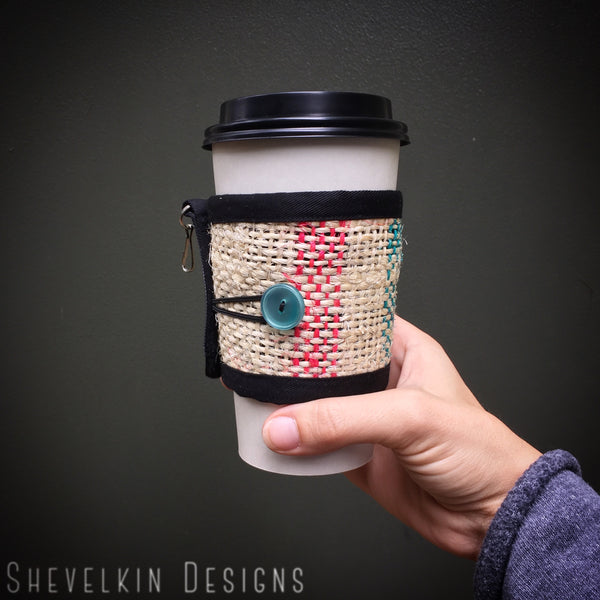 Coffee Cozy for travel or disposable cups with sea foam button and lines in hand