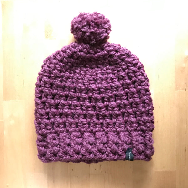 Purple Wool Slouchy Beanie with Pom Pom on table back