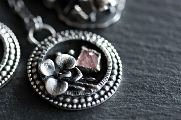 Tavernier faceted Ruby and succulent shadowbox necklace.