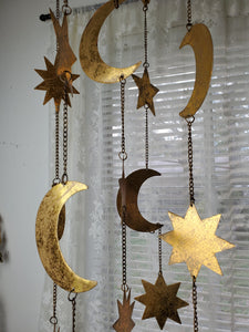 Celestial moon and stars hanging