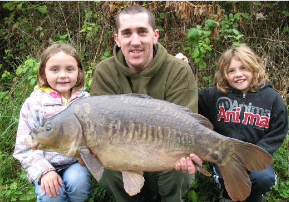Dan with a Canal Linear Carp