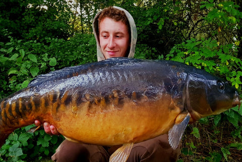 Callum with a Mirror Carp
