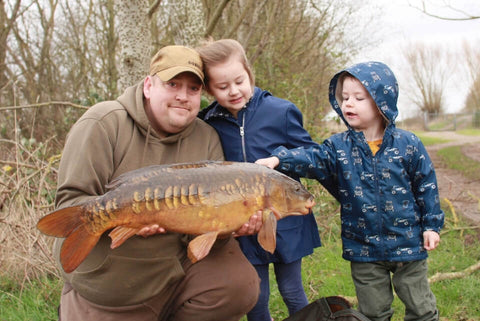 Paul with a Carp and his Children