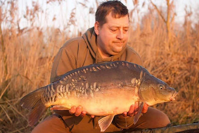 Paul with a Mirror Carp caught on Mystic Plum