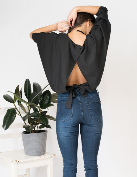 Keyhole crossover tie-back long sleeve top